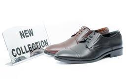 Chaussures en cuir sur le fond blanc Photos libres de droits