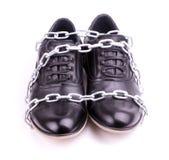 Chaussures enveloppées dans les réseaux Photo stock