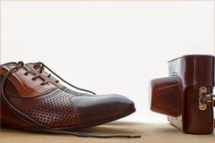 Chaussures et appareil-photo Vieux type Image libre de droits