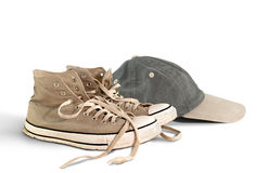 Chaussures et chapeau de base-ball de cru Image stock