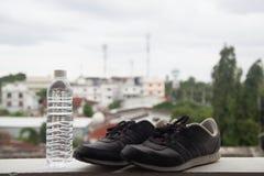 Chaussures et eau Images libres de droits