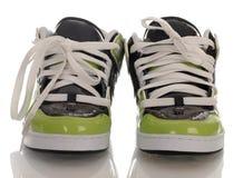 Chaussures faisantes de la planche à roulettes Photos stock