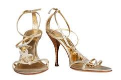 Chaussures femelles de colo d'or Images stock
