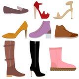 Chaussures femelles réglées sur le fond blanc Photo libre de droits
