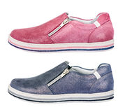 Chaussures folâtres de fille - espadrilles, d'isolement sur le blanc Photographie stock libre de droits