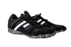 Chaussures génériques de sports sur le blanc Photographie stock libre de droits