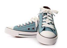 Chaussures grises d'isolement sur le fond blanc Image libre de droits