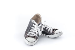 Chaussures grunges noires sur le fond blanc Photo libre de droits