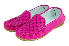 Chaussures lumineuses élégantes roses intéressantes de jeune dame Photos stock