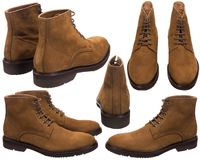 Chaussures masculines de suède avec les dentelles brunes photos libres de droits