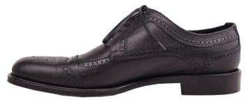 Chaussures noires élégantes sur un fond blanc Image stock