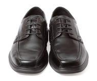 Chaussures noires d'isolement sur le blanc images libres de droits