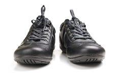 Chaussures noires de sport Images stock