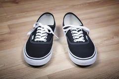 Chaussures noires de sports Images libres de droits