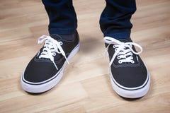 Chaussures noires de sports Photographie stock libre de droits