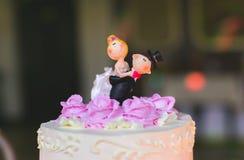 Chaussures nuptiales d'amants d'anneaux de mariage Photographie stock