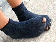 Chaussures ou chaussettes du besoin Photos libres de droits