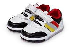 Chaussures pour l'enfant sur le fond blanc Image stock