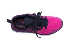 Chaussures roses et noires de femme de sport d'isolement sur le fond blanc Image libre de droits