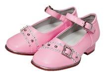 Chaussures roses pour des filles sur le blanc Photographie stock libre de droits