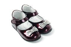 Chaussures rouge foncé d'enfant Photo stock