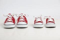 Chaussures rouges d'isolement sur le blanc Photographie stock libre de droits