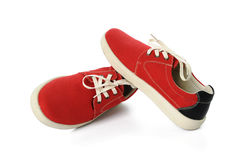 Chaussures rouges islated sur le fond blanc Image stock