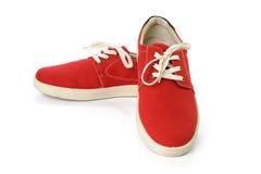 Chaussures rouges islated sur le fond blanc Images libres de droits