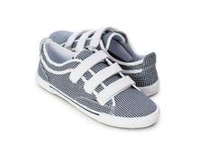Chaussures sportives d'isolement sur le blanc Photo libre de droits