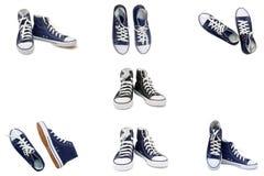 Chaussures sportives - les espadrilles des hommes sur un fond blanc Photographie stock