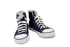 Chaussures sportives - men& x27 ; espadrilles de s sur un fond blanc Photos stock