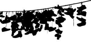 Chaussures sur la corde Images stock