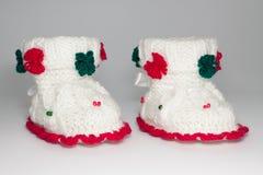 Chaussures tricotées de laine pour les enfants en bas âge Photos stock