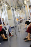 A chave alta borrou a imagem dos passageiros no trem Imagens de Stock Royalty Free