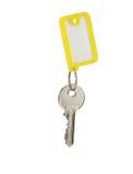 Chave com o Tag em branco isolado no branco Imagem de Stock Royalty Free