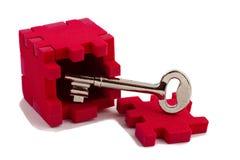 Chave com um enigma do cubo. Imagens de Stock Royalty Free