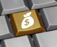 Chave de computador com sinal e bolsa de dólar Imagens de Stock Royalty Free