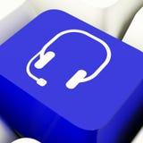 Chave de computador do símbolo dos auriculares em Communiction e em Onl mostrando azuis Foto de Stock Royalty Free