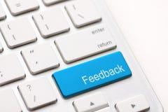 Chave de computador que mostra o feedback da palavra. Imagem de Stock