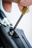Chave de fenda e parafuso e porca Imagem de Stock Royalty Free