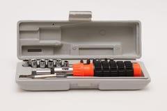 Chave de fenda reversível Um grupo de bocais da chave de fenda em um fundo branco imagens de stock
