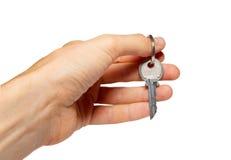 Chave de prata em uma mão. fotografia de stock