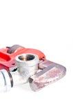 Chave de tubulação que repara uma junção da torneira Fotos de Stock Royalty Free