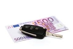 Chave do carro, dinheiro. Fotografia de Stock Royalty Free