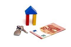 Chave do investimento do dinheiro da casa Imagens de Stock Royalty Free