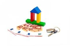 Chave do investimento do dinheiro da casa Fotografia de Stock