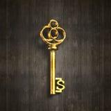 Chave dourada do tesouro da forma do sinal de dólar Imagens de Stock
