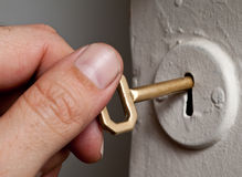 Chave e buraco da fechadura. Fotos de Stock