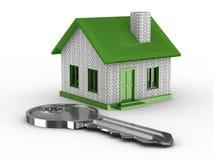 Chave e casa no fundo branco Fotografia de Stock