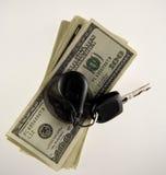 Chave e dólares do carro Fotos de Stock